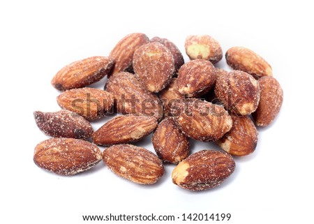 salted and roasted almonds on white background - stock photo