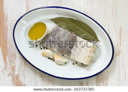 salted cod fish with oil - stock photo