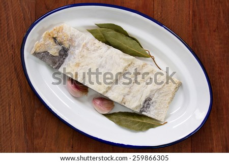 salted cod with bay leaf - stock photo