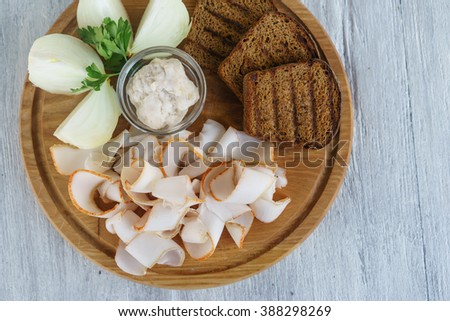 salted lard on wooden cutting board - stock photo