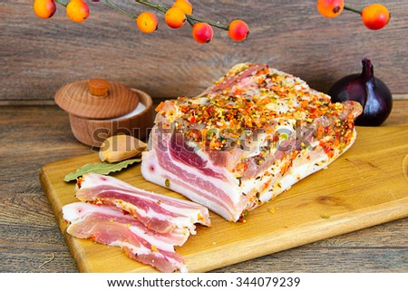 Salted Lard, Raw Pork with Spices on Wooden Cutting Board Studio Photo - stock photo