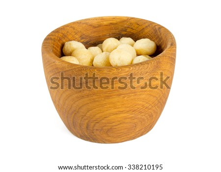 salted macadamia nuts isolated on white - stock photo