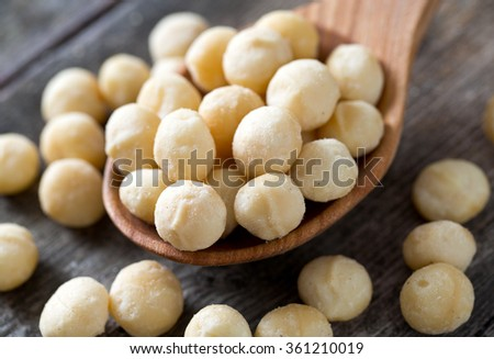 salted macadamia nuts on wooden surface