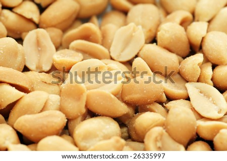 Salted peanuts in close-up - stock photo