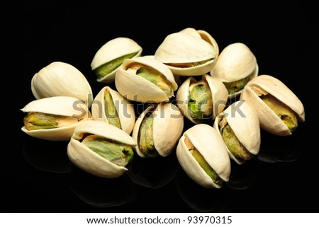 salted pistachio nuts on Black background - stock photo