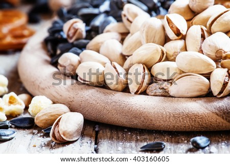 Salted pistachios on a vintage wooden background, selective focus