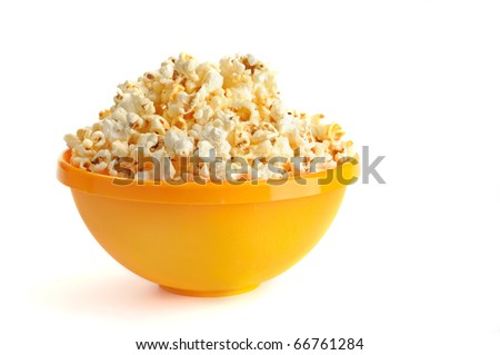 Salted popcorn grains in the yellow bowl - stock photo