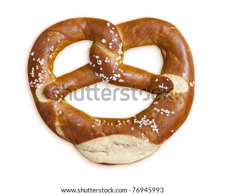 Salted pretzel with clipping path - stock photo