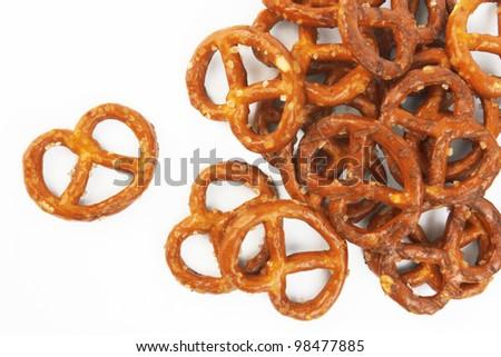 salted pretzels on white background - stock photo
