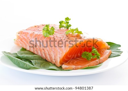 salted red fish with greens on a white background