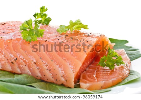salted red fish with greens on a white background - stock photo