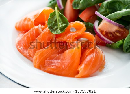 Salted salmon with fresh green salad, selective focus - stock photo