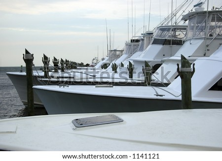 Saltwater Fishing Sport Boats at a Marina in the Morning - stock photo