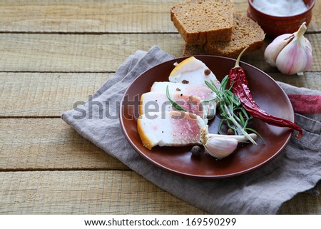 salty bacon with spices, food closeup - stock photo