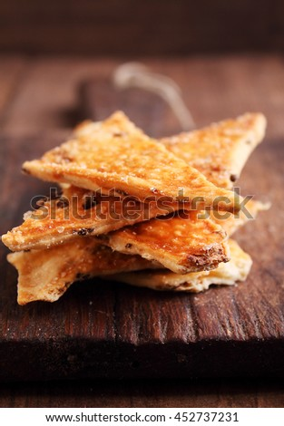 salty cookies (crackers) on a dark background. selective focus. - stock photo