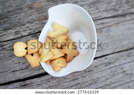 Salty crackers delicious is on the wood background. - stock photo