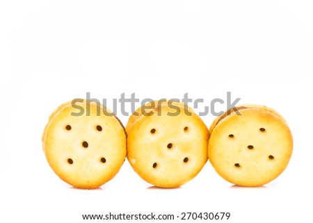 salty crackers stuffed with pineapple jam placed at the bottom of the frame on white background - stock photo