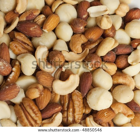 Salty nut mix as a background - stock photo