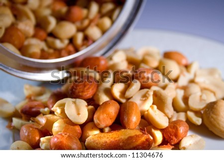Salty nuts with open can ready to eat or serve - stock photo