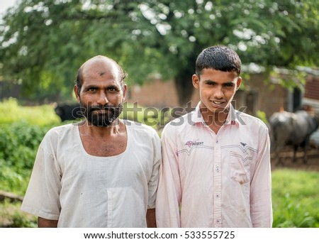 SALUNKWADI, INDIA - August 12, 2016: Rural people daily lifestyle, Indian rural two men in rural village Salunkwadi, Ambajogai, Beed, Maharashtra, India, Southeast Asia.