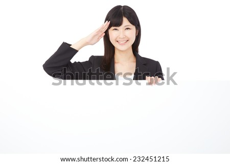 saluting Asian businesswoman with Bulletin Board