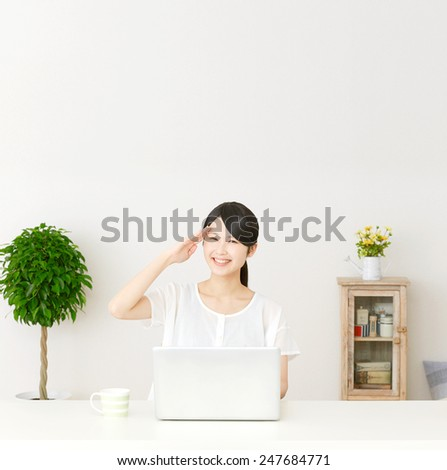 saluting Japanese woman with PC - stock photo