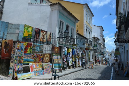 SALVADOR, BAHIA, BRAZIL:09 DEC 2013:paintings are displayed along the alleys at Pelorinho square on 09th Decenber 2013,in Brazil. - stock photo