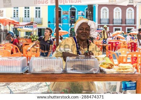 SALVADOR, BRAZIL - CIRCA NOV 2014: Baiana serving Acaraje in Bahia, Brazil. Acaraje is a typical food in the northeast of Brazil. - stock photo