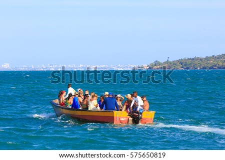 SALVADOR, BRAZIL - JAN 31, 2017: Boat taking people to the Schooners in Itaparica Island