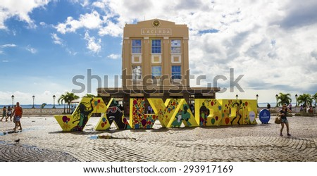 SALVADOR, BRAZIL - MAY 10: Panoramic view of the architecture of the Elevador Lacerda building in Salvador, Bahia, Brazil on a sunny summer day with locals passing by on May 10, 2015. - stock photo