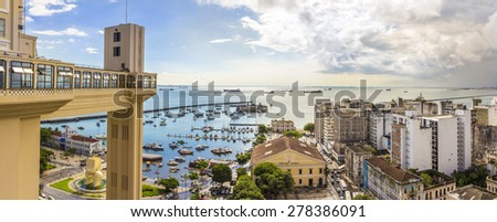 SALVADOR, BRAZIL - MAY 8: Panoramic view of Todos os Santos Bay in Salvador, Bahia, Brazil showcasing the architecture of the Lacerda Elevator and the Modelo Market on a sunny day on May 8, 2015. - stock photo