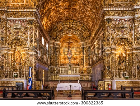 SALVADOR, BRAZIL - MAY 7: The Baroque architecture of Convento de Sao Francisco Church in Salvador, BA, Brazil with its altars, walls, and images covered with 24k gold photographed on May 7, 2015. - stock photo
