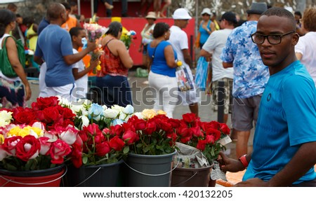 SALVADOR - FEBRUARY 2: Iemanja Party, Afro-Brazilian Festival, Man selling flowers during festival, Rio Vermelho Salvador, February 2, 2016, Brazil. - stock photo