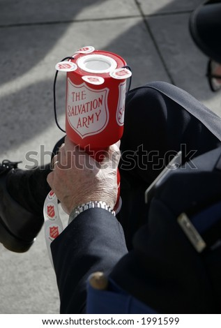 Salvation army collecting money for charity - stock photo