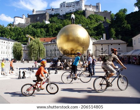SALZBURG,AUSTRIA - JULY 16 ,2014.People at  the historical center of the famous Unesco heritage city of Salzburg, city where Mozart was born.  - stock photo