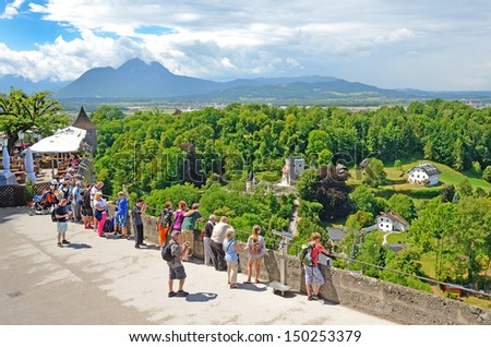 SALZBURG, AUSTRIA - JULY 30: Tourists on the observation deck of fortress Hohensalzburg on July 30, 2013 in Salzburg, Austria. Area of the fortress Hohensalzburg is 30 000 m2.