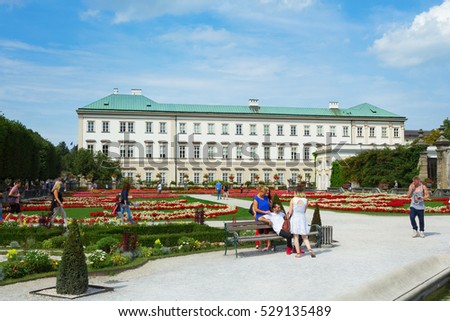 Salzburg, Austria - September 3, 2016: Green lawns and flowers of Mirabell Garden in Salzburg, Austria. Mirabell Garden is very popular place among tourists.