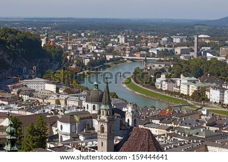 SALZBURG, AUSTRIA - SEPTEMBER 20: View of the historical part of the city and the flowing river Salzach in Salzburg, Austria on September 20, 2010