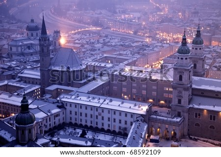 Salzburg city, church and River Salzach in snow during Christmas and New Year Austria