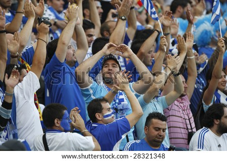 SALZBURG - JUNE 18:  Greece supporters cheer their team prior to a UEFA Euro 2008 Group D match between Greece and Spain at Stadion Wals-Siezenheim June 18, 2008 in Salzburg, Austria. - stock photo