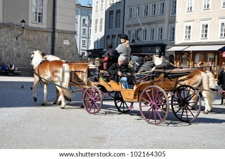 SALZBURG - MARCH 13: Horse driven carriage at Salzburg Spring Days in Salzburg, part of Unesco heritage where the composer, W.A. Mozart was born. On March 13, 2012 in Salzburg, Austria