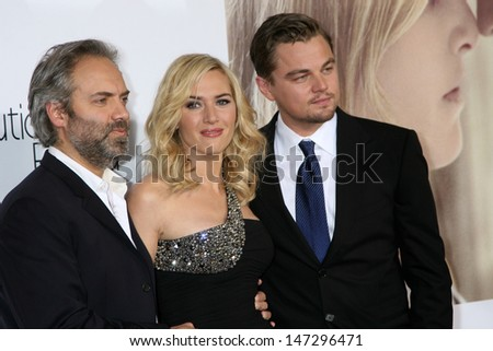 """Sam Mendes, Kate Winslet,  & Leonardo DiCaprio arriving at the World Premiere of """"Revolutionary Road"""" at the Mann's Village Theater in Westwood, CA on December 15, 2008 - stock photo"""
