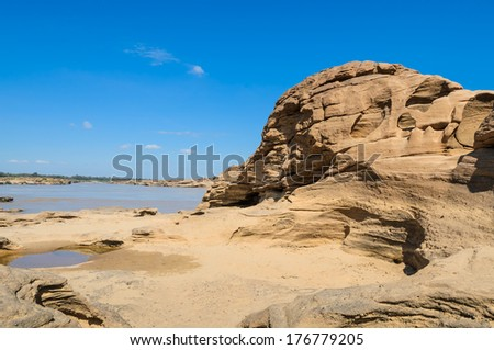 Sam Pan Bok in Ubon Ratchathani, Thailand. The Amazing of Rock shape in Mekong River during summer season. - stock photo