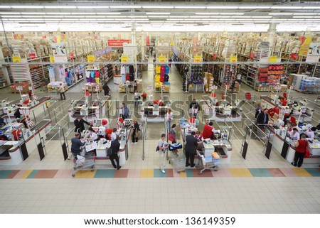 SAMARA - MAY 5: Cashiers check products in Auchan superstore, on May 5, 2012 in Samara, Russia. French distribution network Auchan unites more than 1300 shops. - stock photo