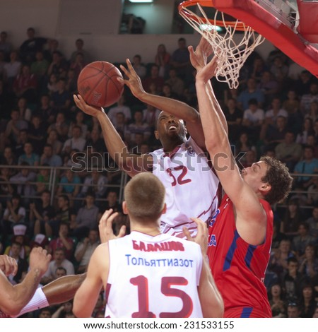 SAMARA, RUSSIA - APRIL 21: Aaron Miles of BC Krasnye Krylia throws a ball in a basket during a BC CSKA game on April 21, 2013 in Samara, Russia. - stock photo