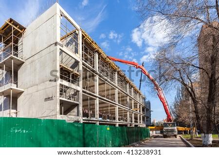 SAMARA, RUSSIA - APRIL 26, 2016: Automobile concrete pumping machine able to pump concrete in large quantities at the construction building - stock photo