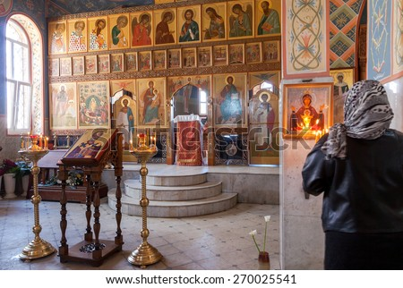 SAMARA, RUSSIA - APRIL 12, 2015: Orthodox Christians inside the Church of  Resurrection in the Holy Resurrection Monastery - stock photo