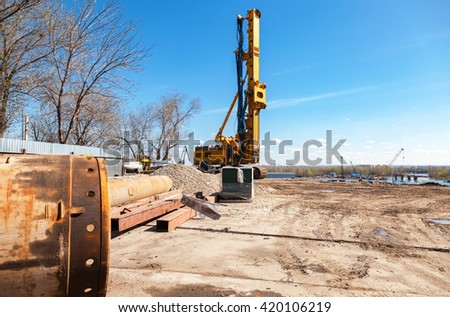 SAMARA, RUSSIA - APRIL 24, 2016: Pile driver at the construction of new Frunze bridge across the Samara river in sunny day