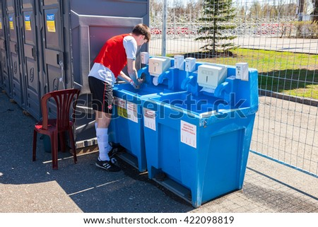 SAMARA, RUSSIA - APRIL 24, 2016: Unidentified athlete washes his hands in the mobile sink near the public toilets - stock photo