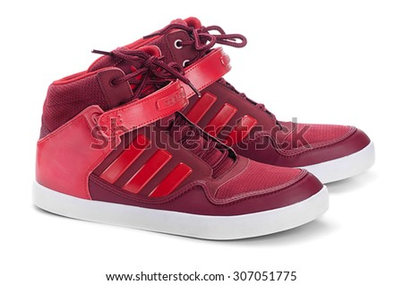 SAMARA, RUSSIA - August 17, 2015: Adidas sneakers for running, football, training, in red, showing the Adidas logo and famous three stripes, illustrative editorial